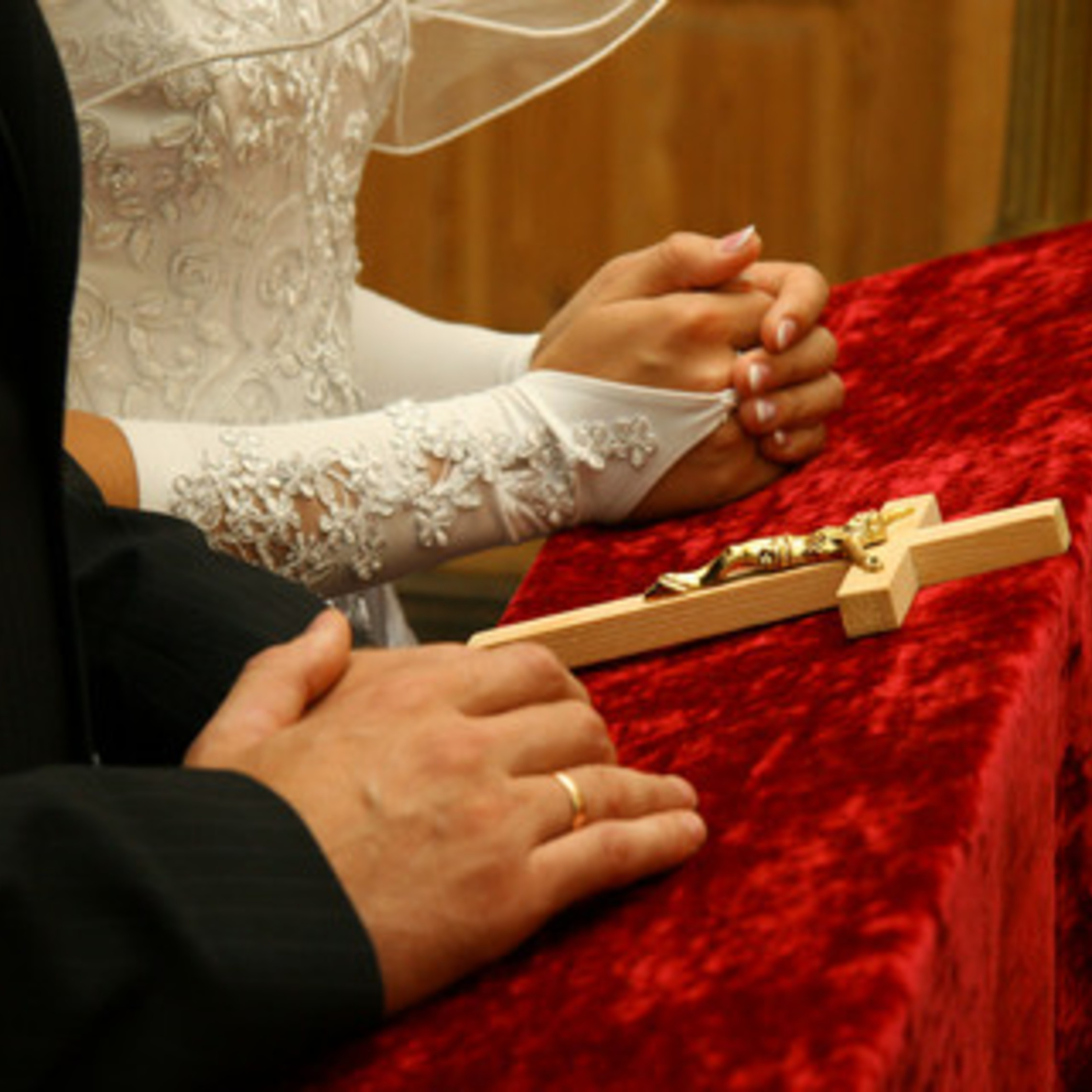 Couple Kneeling With Crucifix