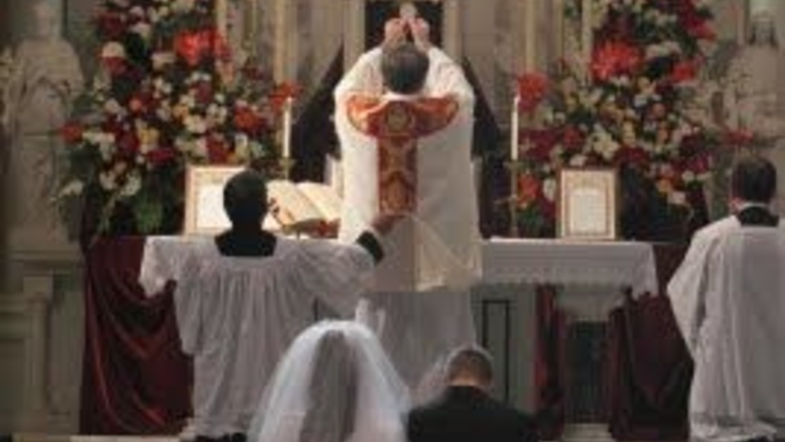 Wedding Couple At Foot Of Altar At Elevation 2