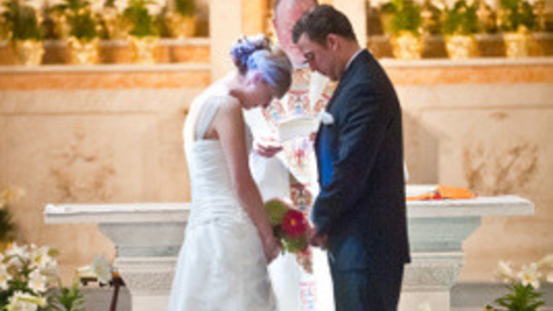 Wedding Couple Bowing In Prayer