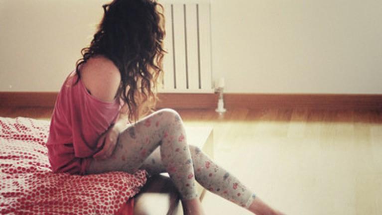 Woman On Bed Looking Outside Window
